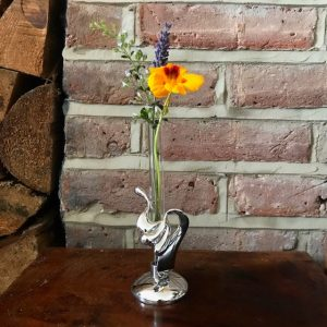 pewter and glass bud vase in use