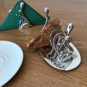 Pewter toast rack with toast