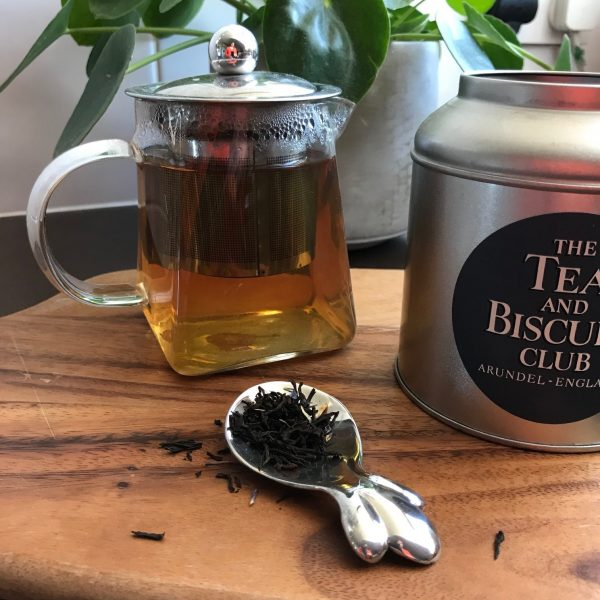 tead caddy spoon with tea pot and tea caddy
